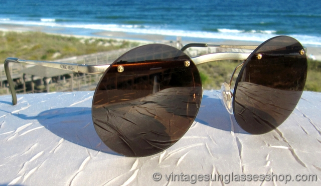 d50c6735da4 VS934  Vintage Giorgio Armani 607 703 rimless sunglasses feature a top gold  plated bar that secures the rimless round brown Armani lenses to the frame