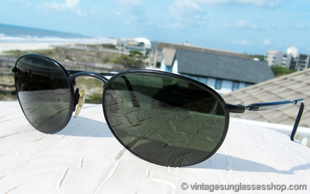 91a38a4ff2 VS2948  Vintage Giorgio Armani 653 706 sunglasses feature a sleek black  chrome front frame and ear stems that make for a perfect color complement  for the ...