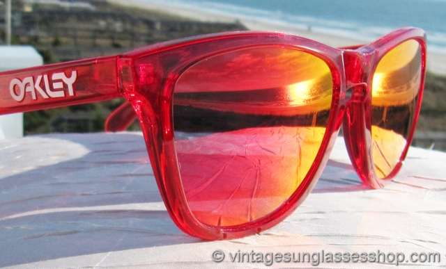 oakley frogskins acid tortoise blue sunglasses  vs1895: vintage oakley frogskins sunglasses feature the rare, out of production acid red frame and oakley ruby iridium lenses that have hues of red and