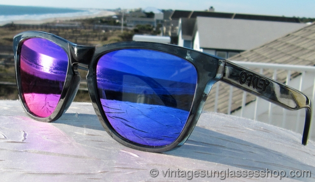 oakley frogskins acid tortoise blue sunglasses  vs1876: vintage oakley frogskins sunglasses feature the super cool acid black frame that incorporates hues of black and gray in a pattern and shading right
