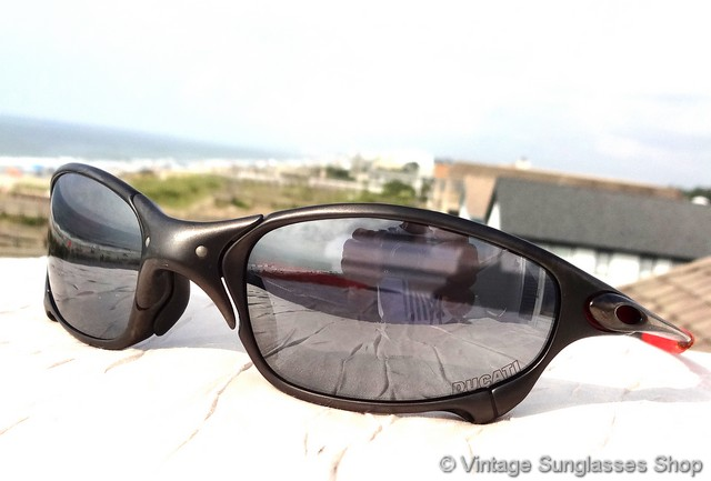 oakley glasses design  vs1884: vintage oakley juliet ducati sunglasses c 2003 feature the low production x metal carbon frame along with oakley black iridium lenses, a sleek,