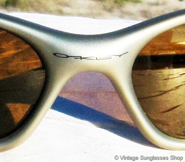 oakley sunglasses 1990s  vs2216: vintage oakley minute sunglasses feature a durable lightweight frame perfect for sports and active pursuits, a beautiful matte gold color that