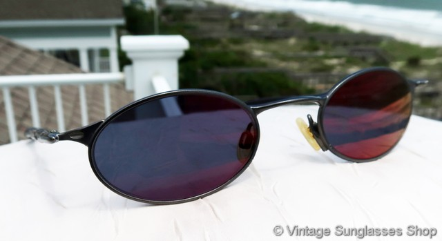 oakley sunglasses names  vs236: very early and very vintage oakley sunglasses have rare purple lenses and a light, exotic frame shape and color that looks far different than modern