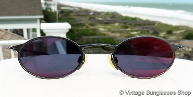 oakley glass color  vs236: very early and very vintage oakley sunglasses have rare purple lenses and a light, exotic frame shape and color that looks far different than modern