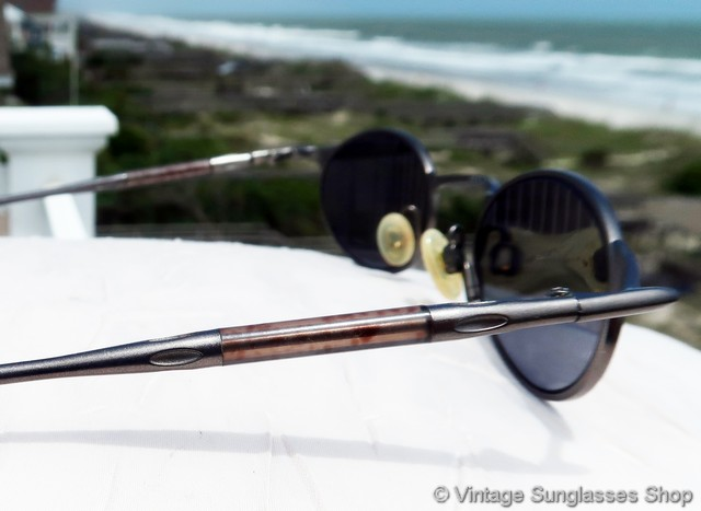 oakley sunglasses old models  vs236: very early and very vintage oakley sunglasses have rare purple lenses and a light, exotic frame shape and color that looks far different than modern
