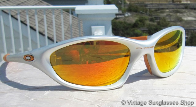 aa73e11bcc7f VS2647: Vintage Oakley XX sunglasses feature a cool silver frame with  orange highlights, a perfect color complement for the highly reflective  Oakley Fire ...