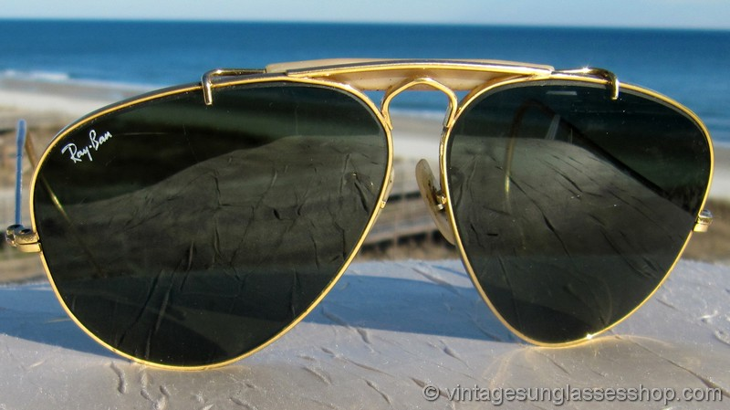bd550e79ee ... Vintage Ray-Ban 58mm military shooter sunglasses feature that  distinctive arched gold plated frame and the uniquely shaped Bausch   Lomb  G-15 anti-glare ...