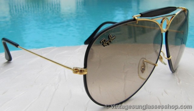 ray ban black glass with golden frame  vs369: unusual and rare special air force issue b&l ray ban bullet hole aviator sunglasses have a striking gold and black frame, black general bar,