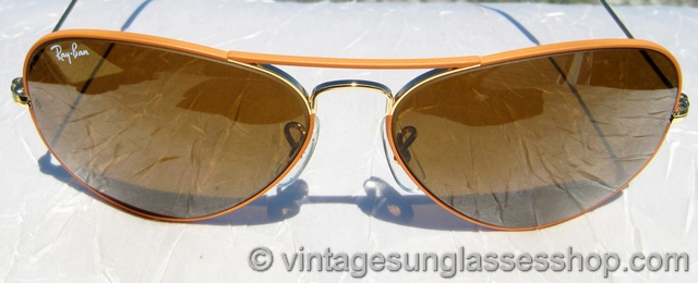 classic ray ban styles  vs2031: vintage ray ban flying colors sunglasses feature a very rare orange enamel covered arista gold plated frame in the classic ray ban 58mm aviator