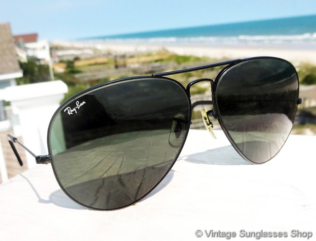 ray ban black glass with golden frame  vs769: vintage ray ban l2821 62mm black aviator sunglasses are a classic of modern sunglass design, with all black ray ban aviator frame holding bausch