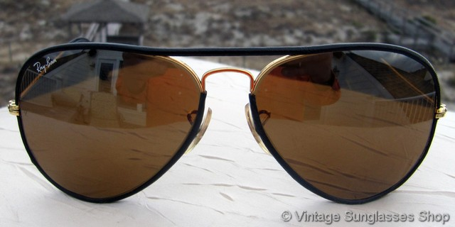 ray ban black glass with golden frame  vs531: very fine vintage b&l ray ban leathers sunglasses feature black english bridle leather wrapping the gold plated 58mm aviator frame that holds bausch
