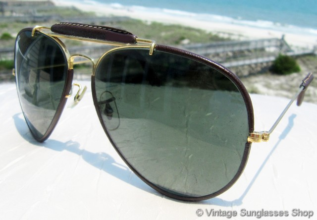 15b000dfeee VS715  Vintage Ray-Ban Leathers General sunglasses feature supple dark  brown English bridle leather covering the gold Arista frame along with a  leather ...