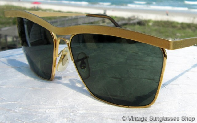 ray ban golden frame glasses  vs1766: vintage ray ban w1303 olympian iii dlx sunglasses feature a distinctive brushed antique gold olympian frame that holds bausch & lomb rb 3 anti glare
