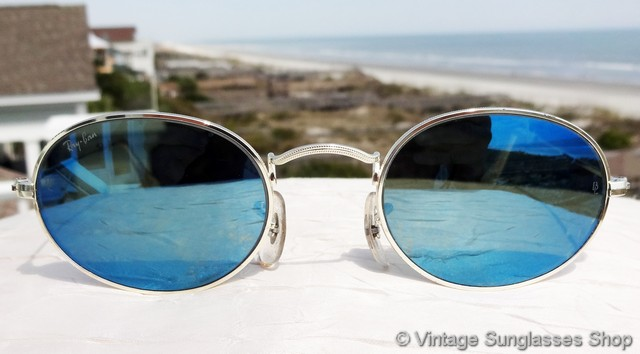 vintage ray ban bausch and lomb  vs652: vintage b&l ray ban w2263 classic collection style 1 blue mirror sunglasses feature a silver arista frame with perimeter etching and rare bausch