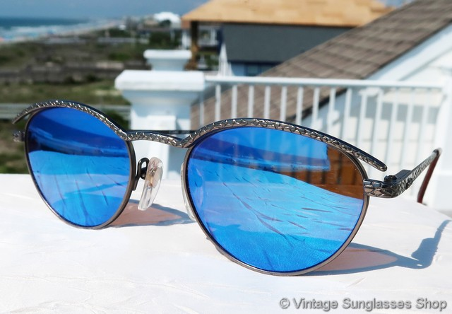 c5b5929572 VS481  Rare vintage Revo 1114 054 Serpent sunglasses feature the Serpent  skin python gunmetal frame combined with Revo s blue mirror lenses that  pick up ...