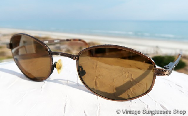 71952f989af0 VS158  Vintage Revo 1211 036 Atherton sunglasses feature an etched antique  bronze Italian frame and top of the line Revo H20 polarized lenses.