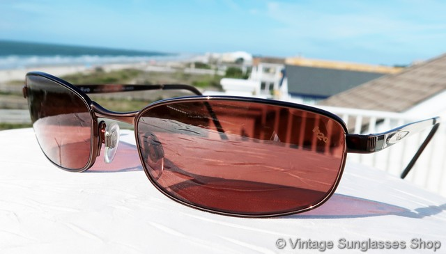 5805b9cd4f1 VS542  Vintage Revo 3040 093 K1 sunglasses feature a gleaming copper  Italian frame and rose tinted and gradient mirrored Revo P H20 polarized  lenses.