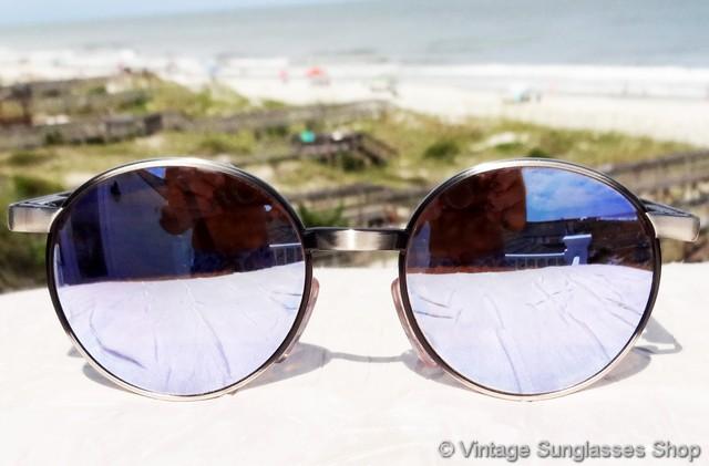 e6d7c79634 VS061  Vintage Revo 960 011 Full Moon sunglasses feature large round Revo  stealth mirror lenses
